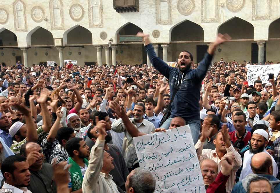 Solidarity: Thousands of Egyptians demonstrated against the Israeli attacks following Friday prayers in the Al Azhar mosque in Cairo as President Mohammed Morsi said that Egypt 'will not leave Gaza on its own'