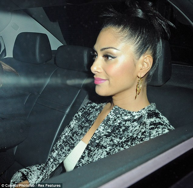 Quiet night: Nicole jumps into her car after eating out in Mayfair but seems to have had a quiet evening