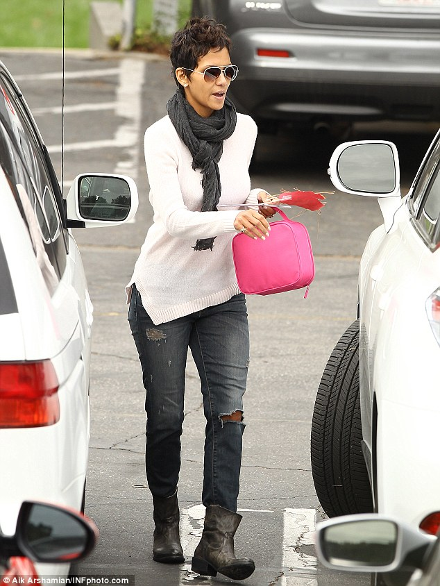 Hardworking: Halle takes Nahla's pink lunchbox and some school work to her waiting car