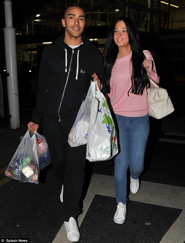 Every little helps: The couple were seen stocking up on snacks and goodies as they left the store