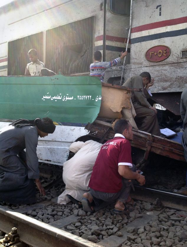 Search for survivors: Distraught Egyptians look for signs of their loved ones in the wreckage of the train crash that killed at least 47 people, most of them children