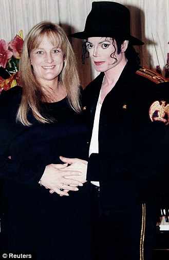 Pop star Michael Jackson and his wife Debbie Rowe