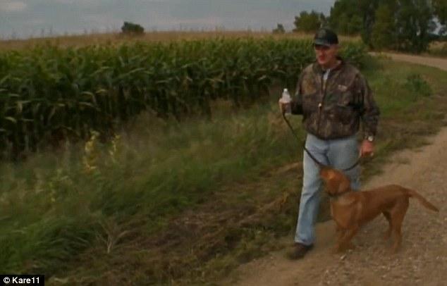 Through the fields: Thomas walks with his dog