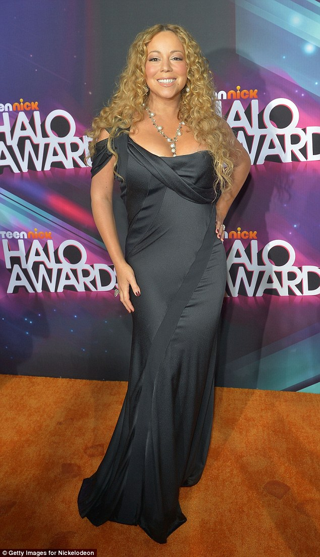Stunning: Mariah Carey's gorgeous black gown - and that revealing decolletage - very nearly stole the show at the HALO Awards on Saturday in Los Angeles