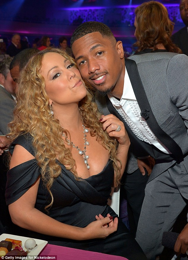 Starry eyed: Mariah is a woman in love as she leans into Nick, cheek to cheek, during the formal event