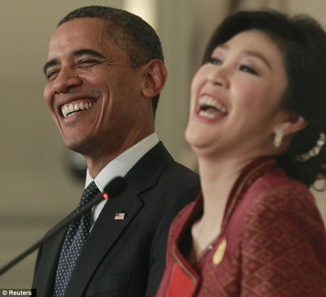 Friendly: Obama and Shinawatra burst into laughter during the press conference
