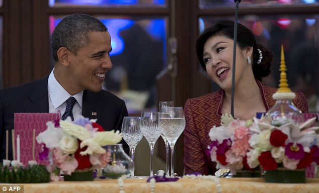 Glances: Obama enjoys a joke with Thai PM Yingluck Shinawatra during a state dinner in Thailand