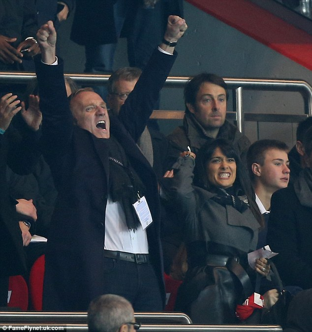 In the spirit: Salma and her husband get into the spirit of things when their team scores a goal