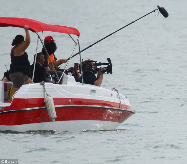 Ready for her closeup: A camera crew from Kourtney & Kim Take Miami captured all of the action from a nearby boat