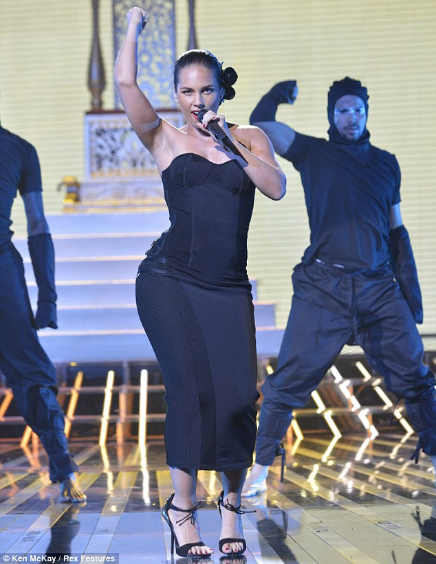 Hot stuff: Alicia Keys performs her debut single Girl on Fire on The X Factor Results Show