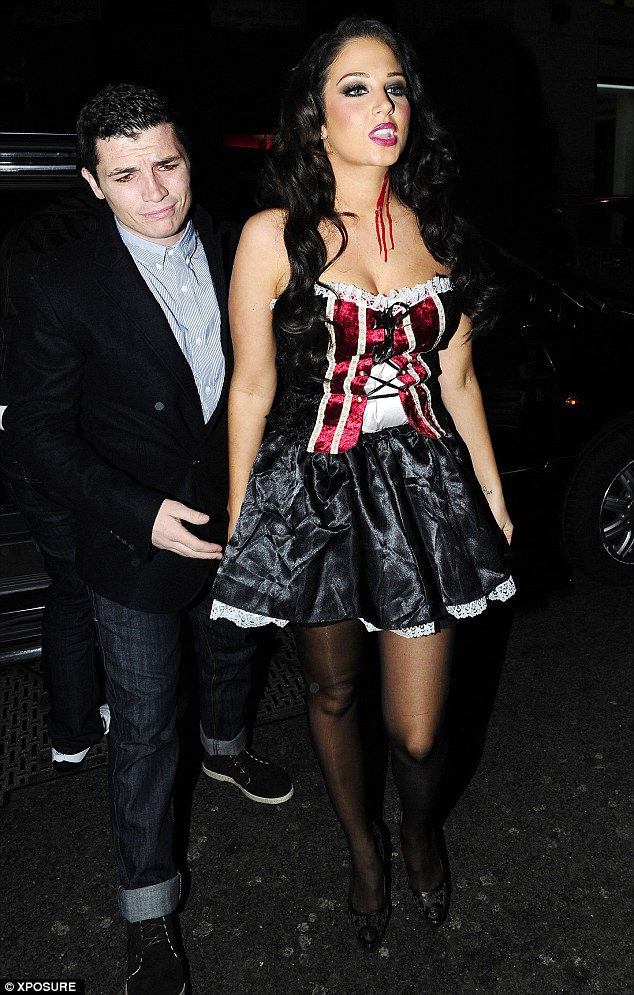 Fangs for the memories: Jody Latham and Tulisa Contostavlos in happier times last month