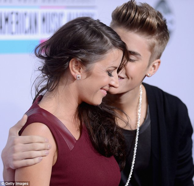 His biggest fan: The teen idol sweetly planted a kiss on his mother's cheek as they walked the red carpet together