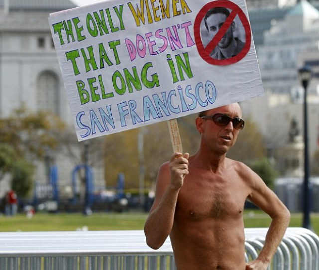 A Nude Man Carries A Sign At Civic Center Plaza In San Francisco California October