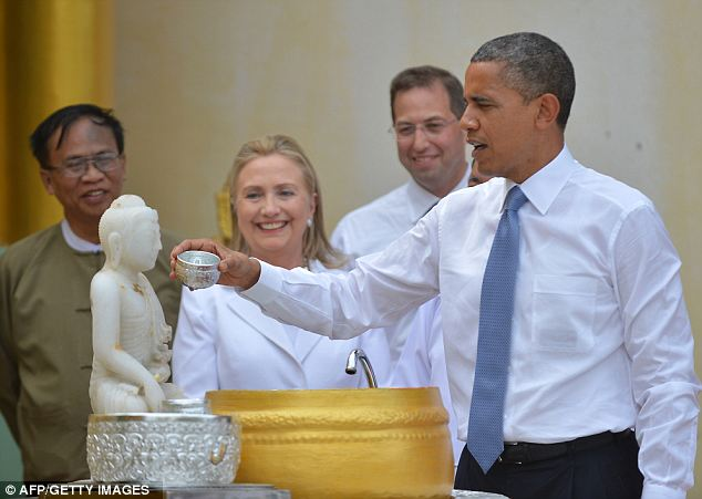Acting like a local: President Obama visited the Shwedagon pagoda as part of the whirl-wind trip