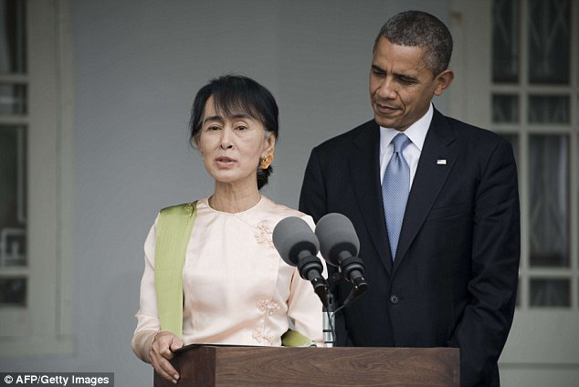 World stage: Obama and Aung San Suu Kyi speak to the media at her residence in Yangon