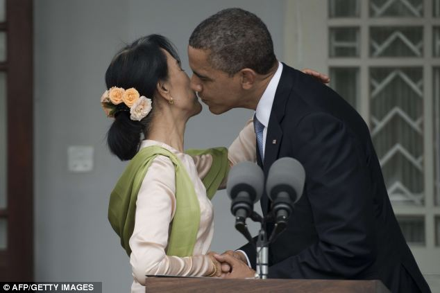 Friendly: Obama kisses Suu Kyi as he visited the country to encourage dramatic political reforms