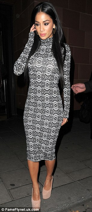 Stunning: Despite her downcast appearance, Nicole looked showstopping as she flaunted her killer curves in a form-fitting printed dress