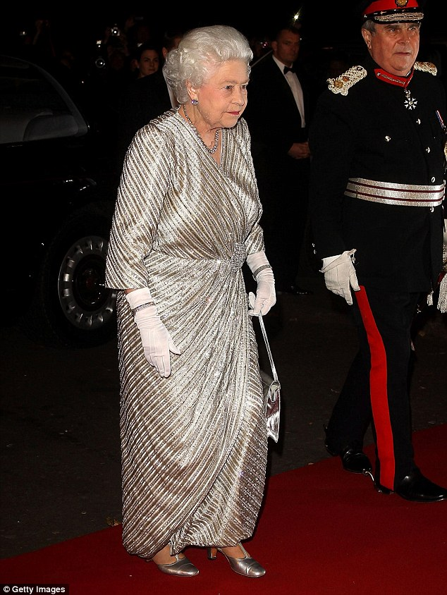 Royal seal of approval: The British monarch dressed in her finest as she glittered her way into the venue on the red carpet