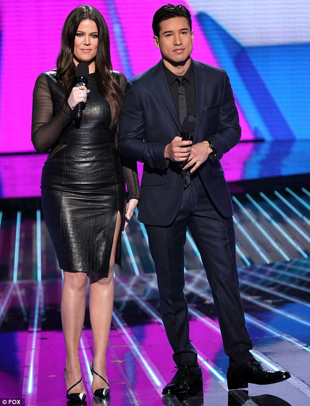 The night job: Khloe glams it up for The X Factor live shows each week where she presents with Mario Lopez