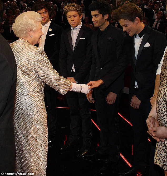 A new Directioner: The One Direction boys looked a little nervous as they shook hands with the monarch