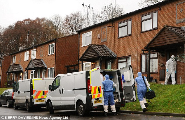Swoop: Police and forensic officers search a house in High Wycombe raided as part of Operation Ribbon