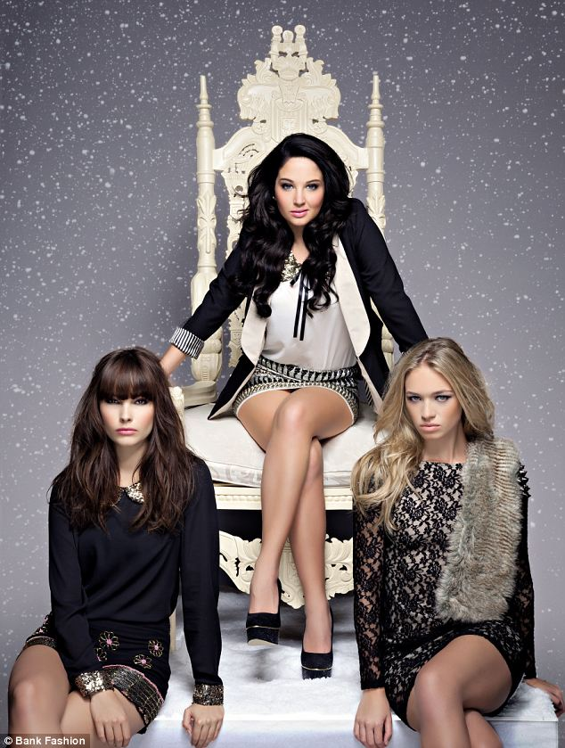 The boss: Tulisa showed who's boss as she sat on a large cream throne while modelling for Bank fashion
