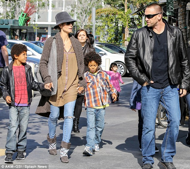 The bodyguard: Heidi was accompanied by her bodyguard/boyfriend Martin Kristen