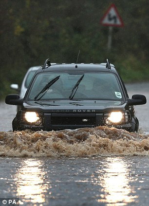 Easy does it: A 4x4 makes light work of deep flood water in Norton near Worcester