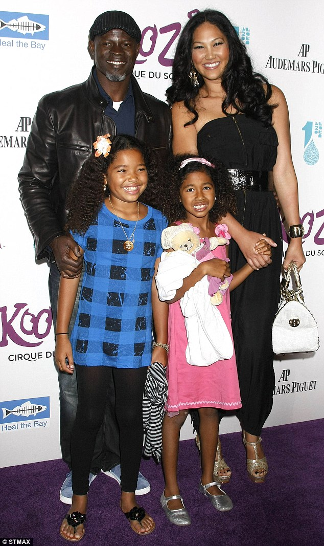 In happier times: The couple pose with Kimora's daughters from her first marriage to Russell Simmons, Ming Lee and Aoki Lee in October 2009