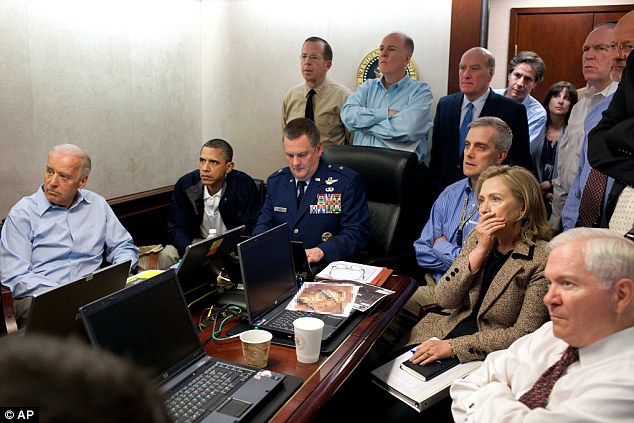 Historic moment: In this May 1, 2011, image, Secretary of State Hillary Rodham Clinton, President Barack Obama and Vice President Joe Biden receive an update on the bin Laden mission in the Situation Room