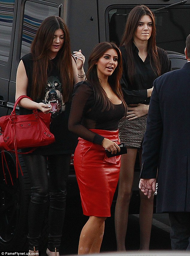 Chatty: Kim was chatting away with her entourage as she arrived for the big event