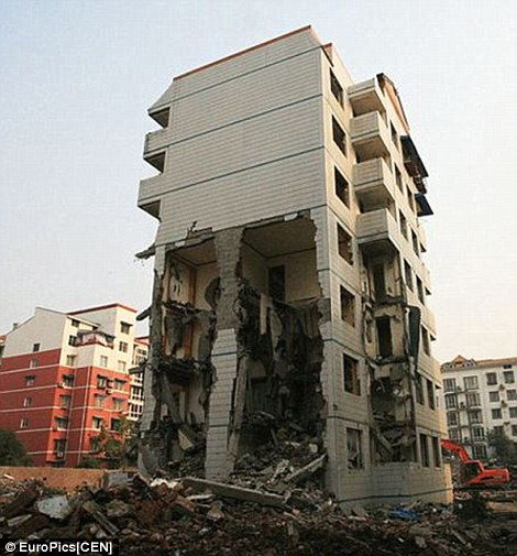 Mum Zhao Yanhong, 42, claimed developers - who want to demolish the flats in Mianyang, south west China, to build a factory - hired thugs to force out other residents but she refused to budge