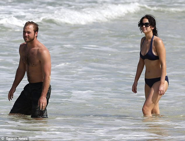 Sibling surf session: Jennifer was seen venturing into the sea with her brother