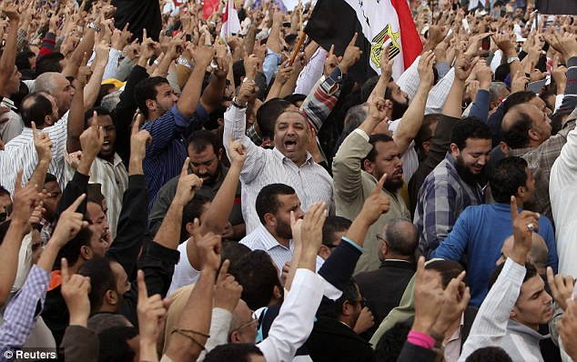 Pro-Mursi protesters chant slogans as they praise a new decree issued yesterday