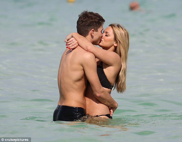 Pucker up! Sam and Joey certainly made sure to put on a passionate display as they frolicked in the sea