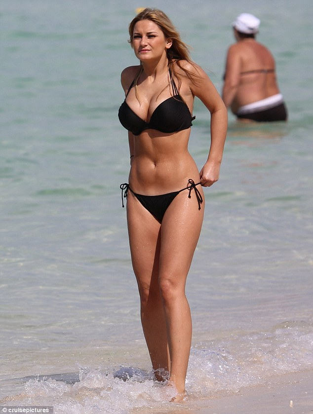 Stunning: Sam flaunted her killer tan and incredible bikini body in a tiny black bikini