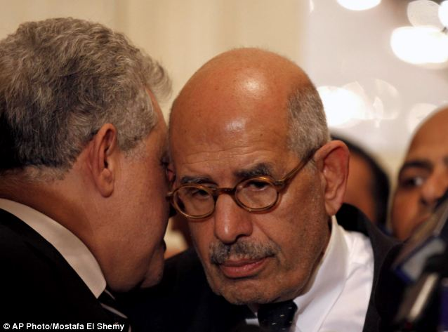 Criticism: Former Egyptian presidential candidate, Hamdeen Sabahi, left, speaks to former director of the UN's nuclear agency and Nobel peace laureate, Mohamed El Baradei,