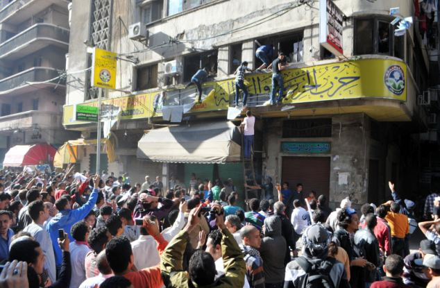 Egyptian opponents of President Mohamed Morsi break into the office of the Freedom and Justice Party (FJP), the political arm of the Muslim Brotherhood, in the Mediterranean port city of Alexandria