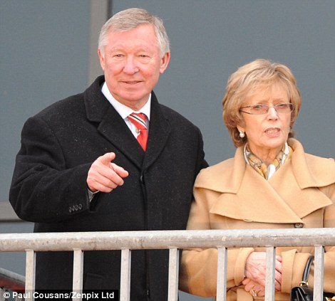 Pointing the way: Ferguson with his wife Cathy