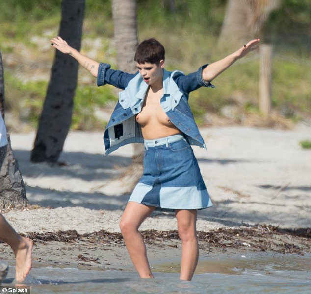 Up in arms: Pixie didn't seem to mind being topless and had fun with her poses on the shoot