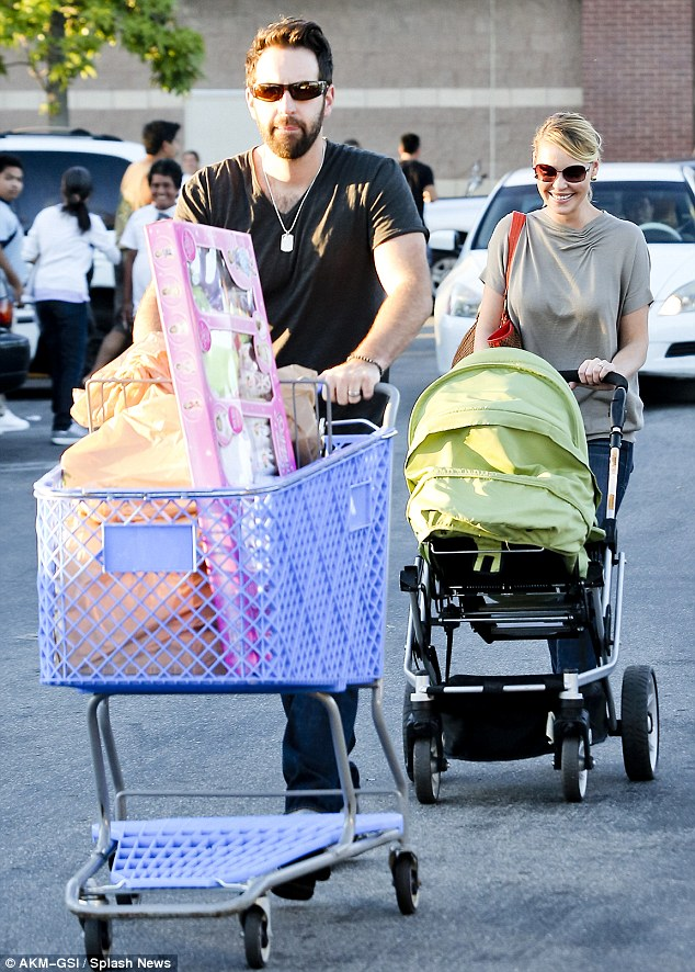 New baby: The couple recently adopted a second daughter and Heigl obviously can't tear her eyes away from her