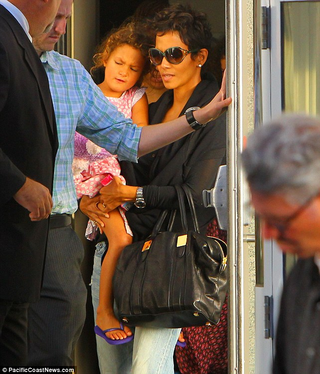 The day after the drama: Halle Berry carries daughter Nahla out of the Nokia Theatre after they saw a performance of the children's band Yo Gabba Gabba, a day after her current beau Olivier Martinez's altercation with ex Gabriel Aubry