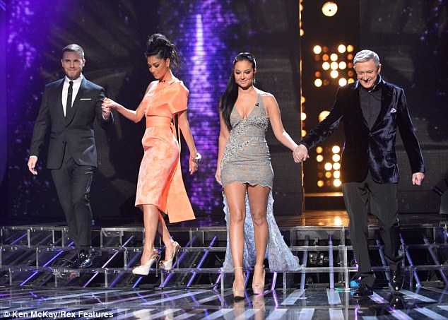 Head to head: Tulisa and Nicole chose to wear their hair up in ponytails as they took to the spotlight in towering heels