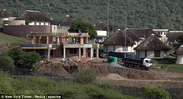 Bewildering: Work continues on Zuma's 'palace' as 31 buildings in his residence get given the go ahead