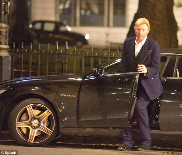 Getaway car: Boris gets into his car as his wife gets a cab