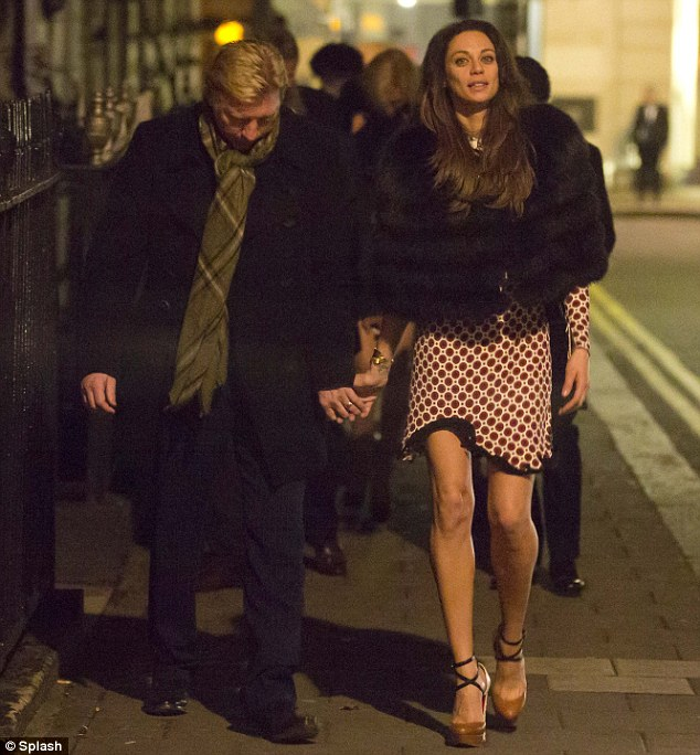 Leaders of the pack: The couple walk hand-in-hand as they lead a procession of their friends out of the club