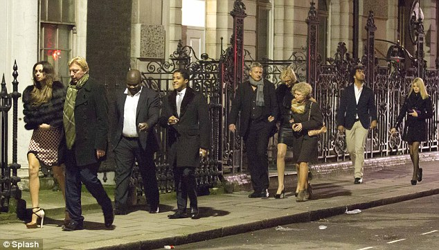 Follow the leader: Boris and Lilly walk in front of their friends after their late night