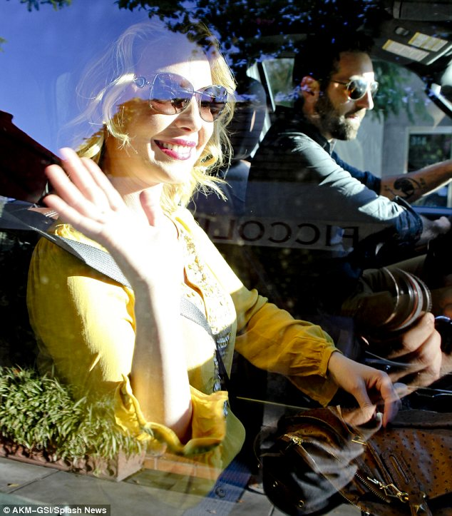 Lots to smile about: The pretty blonde was in a great mood as she gave a wave to photographers before speeding off in Josh's car