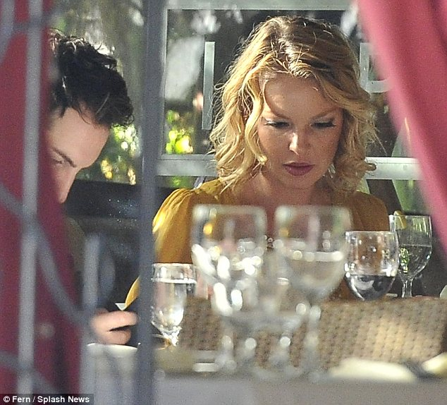 Celebratory meal: The trio dined at a restaurant on Robertson Boulevard in Beverly Hills