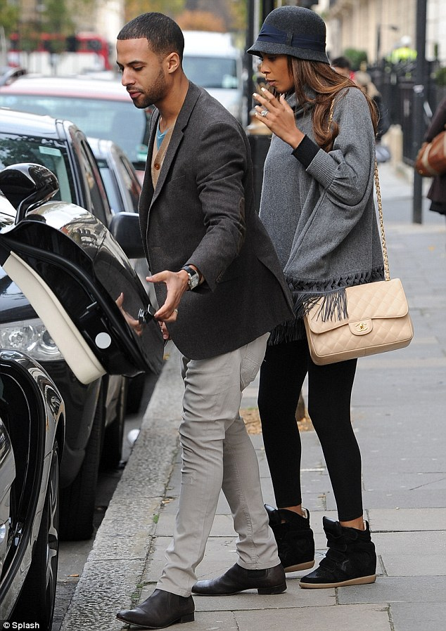 Lady, your carriage await: Marvin opens the gullwing door of his black Mercedes for his wife
